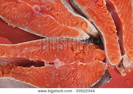 Three Pieces Of A Red Fish On A Red Dish