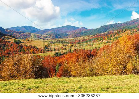 Beautiful Countryside Of Carpathian Mountain. Sunny Weather With Fluffy Clouds On The Sky. Amazing V
