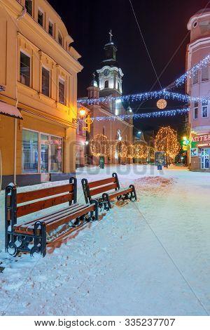 Uzhhorod, Ukraine - 06 Jan, 2019: Winter Night In Town. Wonderful Blue And Yellow Christmas Illumina