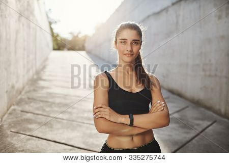 Can You Beat Her Running Record. Motivated And Confident Sportswoman In Black Sportsbra And Shorts,