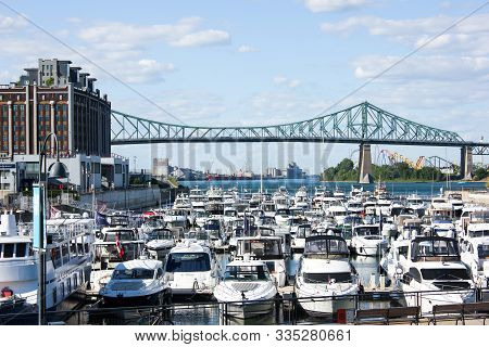 Montreal, Quebec, Canada- 07-09-2012: Jacques-cartier Bridge Seen From The Old Port Of Montreal Near