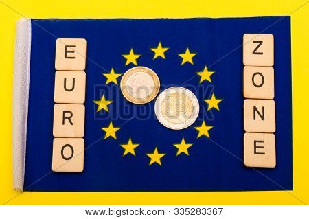 European Union Concept Showing The Flag Of The Eu On A Yellow Background With A Sign Reading Euro Zo