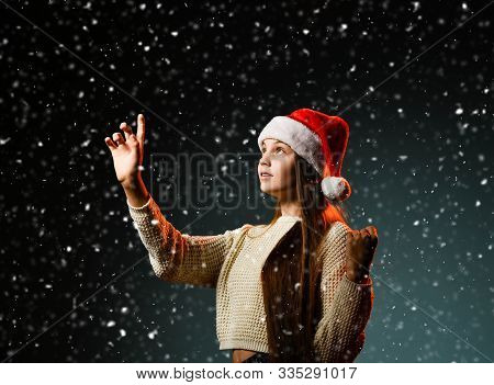 Teenager Girl Young Gentle Woman In Red Cap And Short Knitted Sweater Is Touching Snowflakes With He