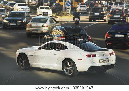 Kiev, Ukraine - October 14, 2019: White Muscle Car Chevrolet Camaro In Motion