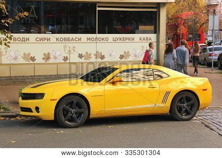 Kiev, Ukraine - October 14, 2019: Yellow Muscle Car Chevrolet Camaro In The City