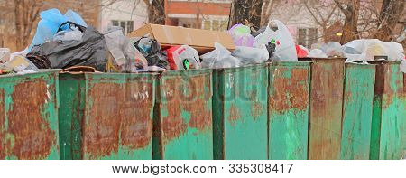 Overfilled Garbage Cans Concept Of Environmental Protection Or Clean Urban Space Wide View.