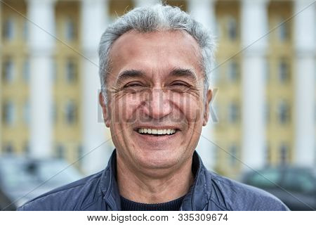 Closeup Laughing Face Of An Elderly Businessman, Civil Servant, Doctor Or Television Presenter. Port