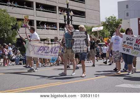 Salt Lake City, Utah - June 3: A Proud Mormon Mother In The Pride Parade Marching In Downtown On Jun