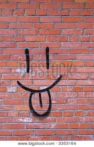 Smile Graffiti On Red Brick Wall In Back Alley