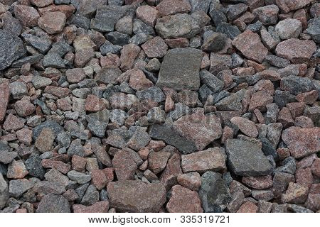 brown gray stone background of fine wet rubble in a heap poster
