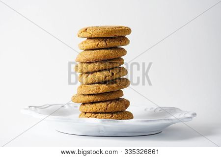 A Stack Of Ginger Cookies On A White Plate Isolated On A White Background With Copy  Space