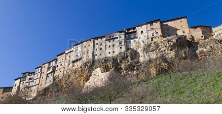 Old Houses on the edge of the cliff in Frias, Burgos, Castilla, Spain poster