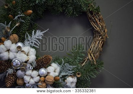 Christmas Wreath Of Vines Decorated With Fir Branches, Christmas Balls And Natural Materials, New Ye