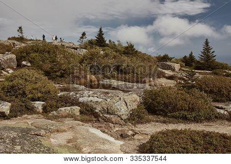Mount Desert Island, Maine - September 27th, 2019:  Hiking Along Granite Bedrock On The Summit Of Ca