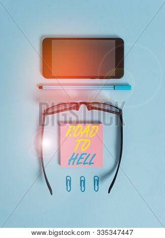 Word writing text Road To Hell. Business concept for Extremely dangerous passageway Dark Ri Unsafe travel Dark eyeglasses colored sticky note smartphone pen clips pastel background. poster