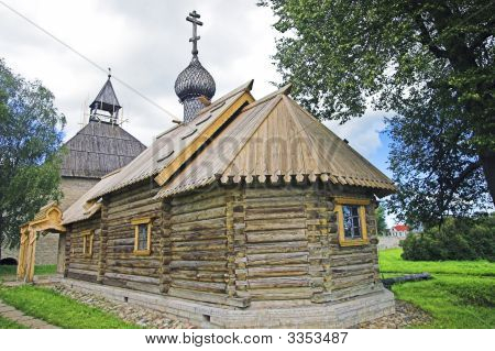 Ancient Russian loghouse church near Saint Petersburg Russia. poster