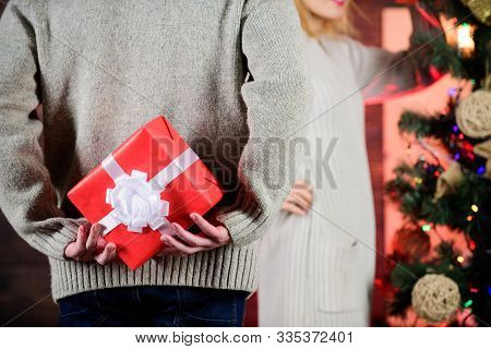 Prepare Surprise. Winter Surprise. Man Carry Gift Box Behind Back Defocused Background. Christmas Su