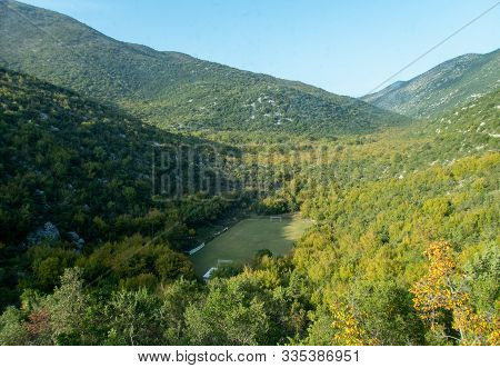 Stock Photo Of Football Field Hidden Between Mountains In Dubrovnik, Croatia. Travel Concept