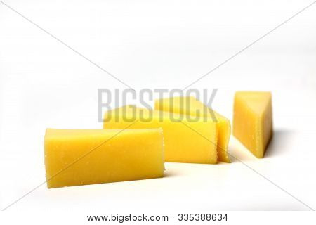 Slices Of Edam Cheese Isolated On White Background