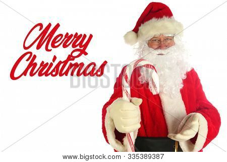 Santa Claus. Christmas Santa. Isolated on white. Room for text. Santa Claus holds a Giant Candy Cane. Peppermint Red and White Striped Candy Canes are popular at Christmas. Merry Christmas text.