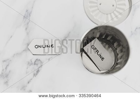 Social Media And Living Life Online Conceptual Still-life, Garbage Bin With Offline And Online Signs