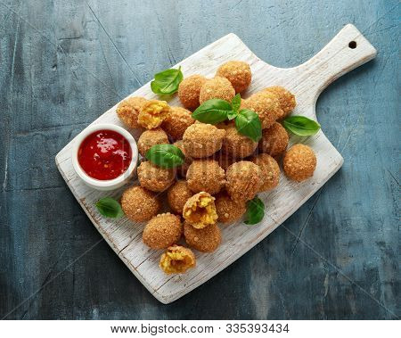 Fried Rice Balls With Sweet Hot Sauce On Wooden White Board
