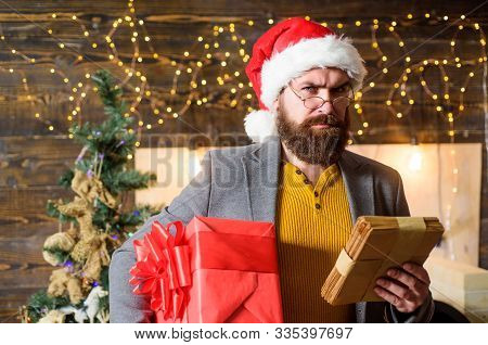 Post For Santa Claus. Man Bearded Hipster Wear Santa Hat Hold Bunch Of Letters And Gift Box. Letter