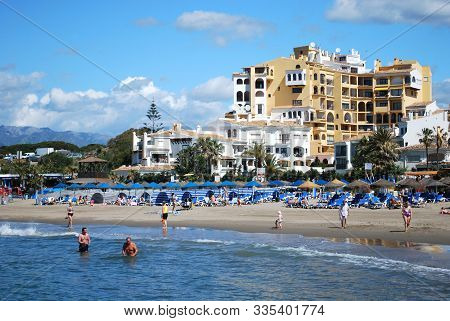 Marbella, Spain - May 17, 2008 - Tourists Relaxing On The Beach With Apartments To The Rear, Cabopin