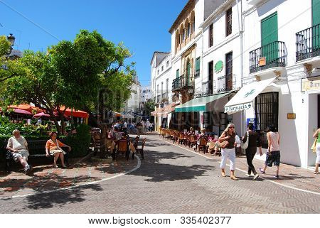 Marbella, Spain - May 26, 2008 - Tourists Relaxing At Pavement Cafes In Orange Square, Marbella, Mal