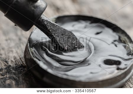 Macro Shot Of An Electric Soldering Iron. A Close-up Of A Sting Of An Anther That Is Dipped In Rosin