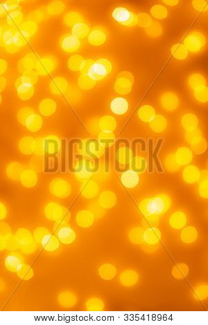 Bokeh Background Of Abstract Glitter Lights, Yellow, Orange, Gold, De Focused.