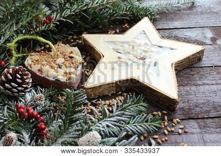 The Picture Shows A Homemade Birdseed On Wooden Boards