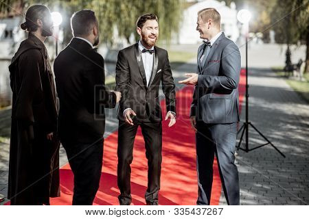 Men As A Famous Movie Actors Gathering Together And Greeting Each Other On The Red Carpet At The Awa
