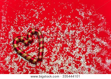 Heart-shaped Christmas Decorations On A Red Background. Festive Mood, Luxury Party, Winter Holidays.