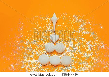 Card With Christmas Tree Of Balls On Yellow Sparkle Bakground. White Decorations, Festive Mood, Luxu
