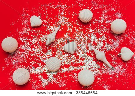 Card With Christmas Balls On Red Sparkle Bakground. White Decorations, Festive Mood, Luxury Party, W