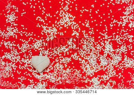 Card With Christmas Heart-shaped Ball On Red Sparkle Bakground. White Decorations, Festive Mood, Lux