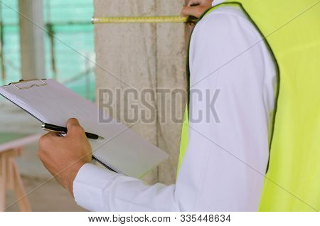 Inspection. Young Foreman Builder, Engineer Or Inspector Checking And Inspecting With Clipboard And