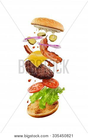 Mouthwatering Cheeseburger With Flying Ingredients. Fast Food Industry