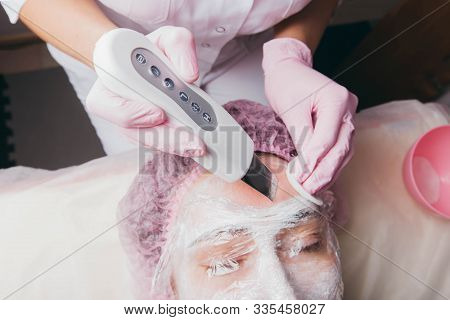 Women On Procedure In Cosmetological Clinic. Mask, Ultrasonic Cleaning, Mechanical Exfoliation, Diam