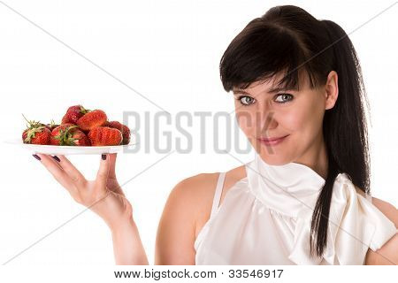 Playful woman with strawberries on plate