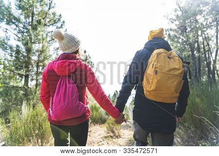 Beautiful Couple Walking Together In The Mountain. Lovely Couple Hiking In The Mountain. Spanish Cou