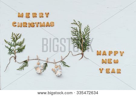 Cookies In The Shape Of The Letters, Laid Out In The Words Merry Christmas And Happy New Year. Flat
