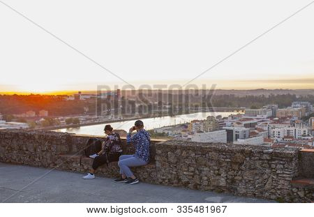 Coimbra, Portugal - Sept 6th 2019: Visitors Couple Enjoy The Sunset From Viewpoint At Coimbra Old To