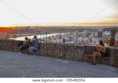 Coimbra, Portugal - Sept 6th 2019: Visitors Enjoy The Sunset From Viewpoint At Coimbra Old Town, Por