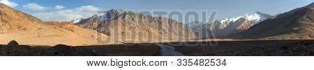 Beautiful Landscape Panorama Of Pamir Mountains Area In Tajikistan. River Valley.