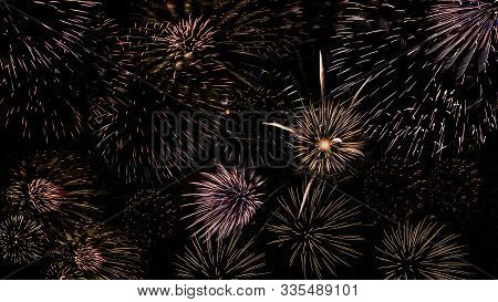 A Beautiful Fireworks Light Up The Sky With Dazzling Display On Dark Background.