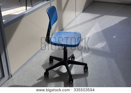 Cleaning The Room From Dust. A Chair For Sitting At A Table In The Office. The Workplace Of The Empl