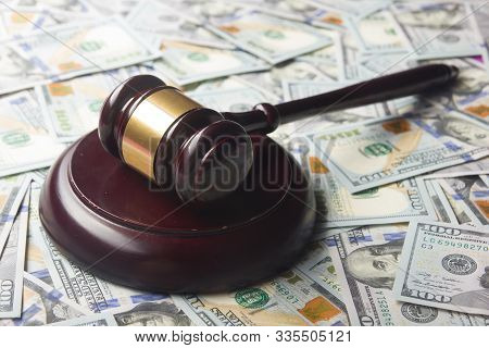 Judges Or Auctioneer Gavel On The Dollar Cash Background, Top View, Close-up. Concept For Corruption