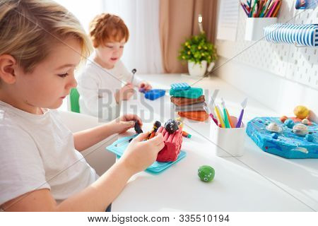 Cute Kids Are Creating The Hand Crafts From Modelling Plasticine At Kids Room